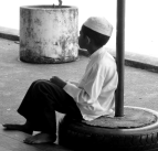 A schoolboy, lost in his thoughts..